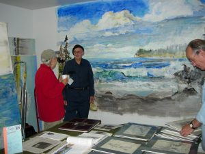 Curt and neighbor Gail Pearlman chat about his work