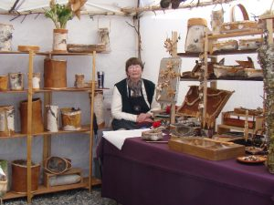 Ardella at her art booth in Talkeetna