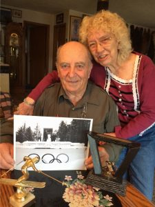 Carl and Brenda Thomas with a picture of Carl at the 1964 Winter Olympics.