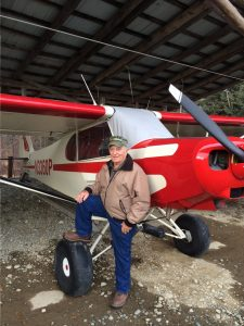 Carl Thomas with his Piper Super Cub.  Photo:  Katie Writer