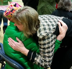 """Talkeetna Elementary Principal Lisa Shelby embraces Elinore Ebling, wife of the late Myron F. """"Ace"""" Ebling, for whom VFW Post 3836 is named.  Photo: AJ Sullivan"""