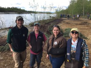 (L to R) Franklin Dekker, a hydrologist for US Fish and Wildlife Service, Catherine Inman with Mat-Su Conservation Services, Tracy Smith with the Alaska Department of Fish and Game, property owner Geri McCain. Photo by Katie Writer - KTNA