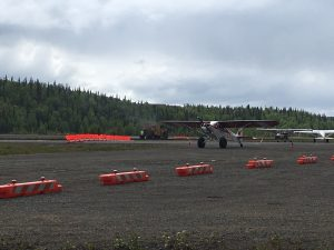 An aircraft uses the temporary taxiway at Talkeetna State Airport as paving work gets ready to begin.  Photo by Katie Writer - KTNA