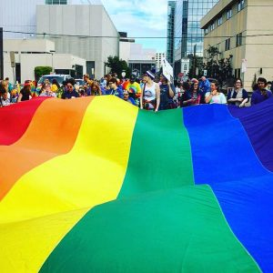 A large Pride flag at Pride Fest in Anchorage.  Photo courtesy of Lillian Rust