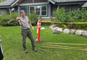 Denali National Park Ranger Roger Robinson tries his hand at the atlatl demonstration. Photo: Phillip Manning - KTNA
