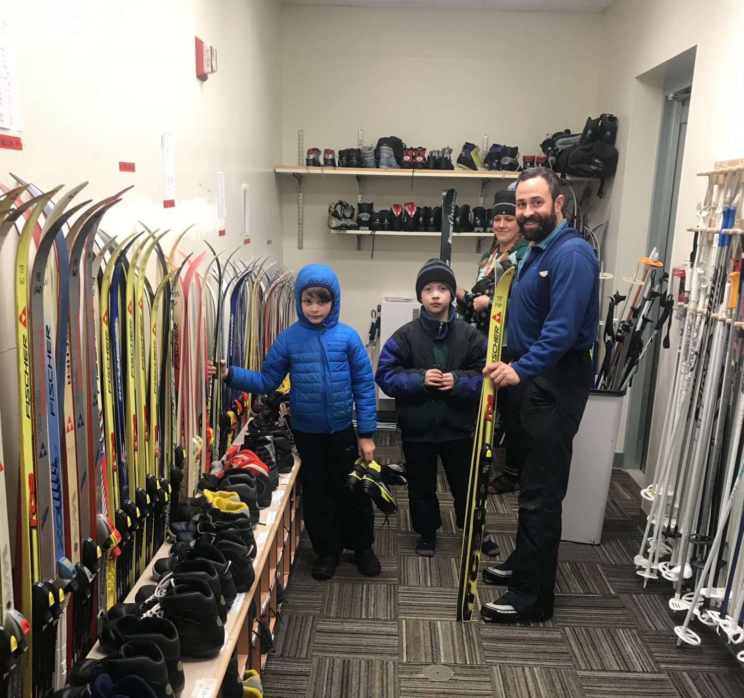 Jamie Westnedge and students in the cross-country equipment room